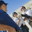 Instructor with man and woman at firing range — Stockfoto
