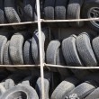 Stock Photo: Old Tires In Rack