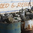 Sign And Rusty Barrels In Junkyard - Stock Photo