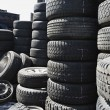 Stock Photo: Tires Stacked Up In Junkyard