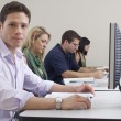 Male Student With Classmates In Computer Lab — Stock Photo