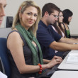Stock Photo: Female Student With Classmates In Computer Lab