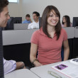 Students Sitting Together At Computer Desk — Stock Photo #21802381