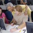 Senior Teacher Assisting Students — Stockfoto