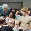 Professor Assisting Students In Class — Stock Photo #21803075