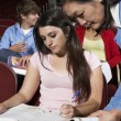 Stock Photo: Teacher Assisting Female Student