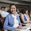 Happy Woman With Friends In Classroom — Stock Photo