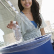 Stock Photo: Female Student Throwing Plastic Bottle In Dustbin