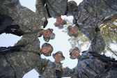 Low Angle Portrait Of Soldiers Huddling — Stock Photo