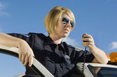 Police Officer Using Two-Way Radio — Stock Photo