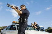 Police Officer Aiming Shotgun — Stockfoto
