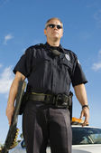 Police Officer Holding Weapon — Stockfoto