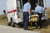 Paramedics With Victim On Stretcher — Stock Photo