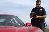 Policía de tránsito con coche deportivo — Foto de Stock