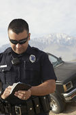 Police Officer Taking Notes — Stock Photo