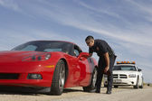 Traffic Cop Stopping Red Sports Car — Stock Photo
