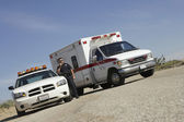 Police Officer By Patrol Car And Ambulance — Stock Photo