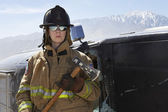 Female Firefighter Holding Axe — Stock Photo