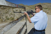 Man Aiming Rifle At Firing Range — Stock Photo