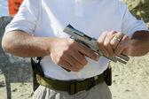 Man Loading Hand Gun At Firing Range — Stock Photo