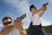 Man And Woman Aiming Hand Guns At Firing Range — Stock Photo