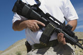 Man Holding Machine Gun At Firing Range — Stock Photo