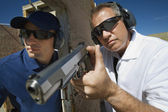 Instructor Assisting Officer With Hand Gun — Stock Photo