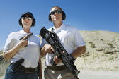 Man And Woman Holding Guns At Firing Range — Stock Photo