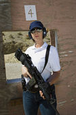 Woman Holding Machine Gun At Firing Range — Stock Photo