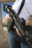 Woman Holding Machine Gun At Firing Range — Stock Photo