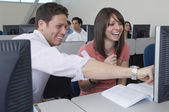 Happy Students Sitting Together At Computer Desk — Foto Stock