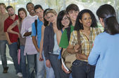 Row Of Students And Teacher At Corridor — Stock Photo
