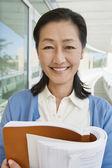 Female Professor Holding Book — Stock Photo