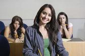 快乐的女学生在教室里 — 图库照片