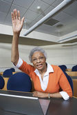 Senior Teacher Raising Hand — Stock Photo