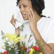 Woman With Allergy Holding Tissue Near Flowers — Stockfoto