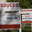 Stock Photo: Real Estate Signs at Foreclosed Property