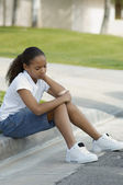 Girl Sitting On Curb — Stock Photo