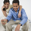 Couple Placing Order On Cell Phone - Stock Photo