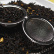 Strainer On Dry Tea Leaves — Photo
