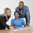 Stock Photo: Office Workers With Manager In Meeting