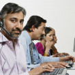 Customer Service Operator With Colleagues In The Office — Stock Photo