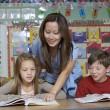 Stock Photo: Teacher Assisting Students