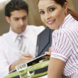 Businesswoman Smiling With Man Signing In Restaurant — Stock Photo