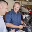 Stock Photo: Two Mechanics At Work