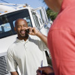 Truck Driver With His Coworker - Stock Photo