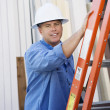 Industrial Worker Standing By A Ladder — Stock Photo