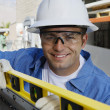 Workman Using a Spirit Level — Stock Photo #21829623