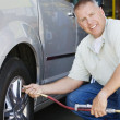 Mechanic Inflating RVs Tire — Stock Photo #21829675