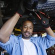 Auto Mechanic Beneath A Car — Stock Photo #21829705